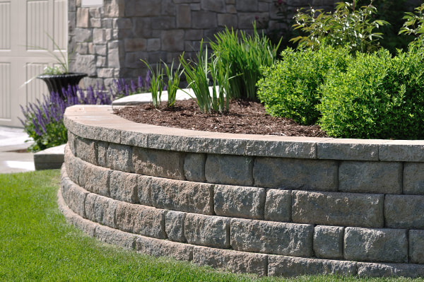 Curved grey stone landscape retaining wall