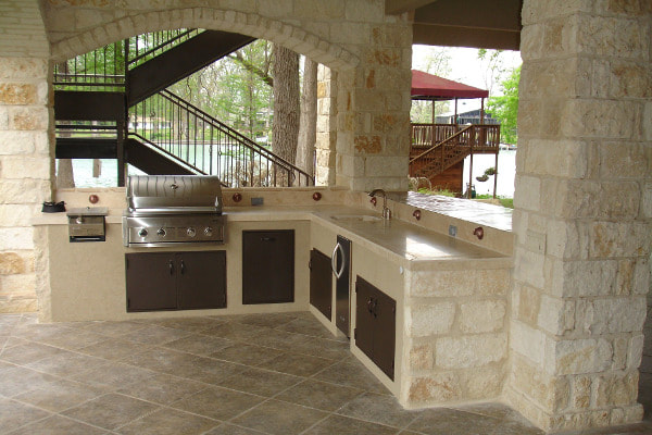 Beige stone outdoor kitchen and barbeque